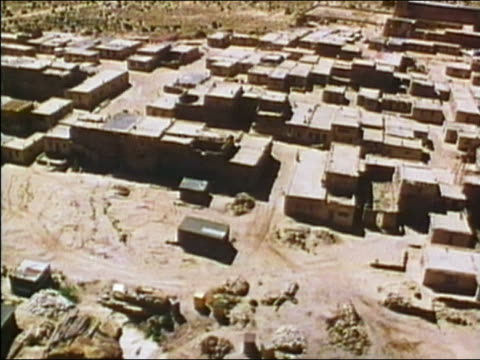 1975 aerial over buildings on mesa and tree-lined valley / mesa verde, colorado - mesa verde nationalpark stock-videos und b-roll-filmmaterial