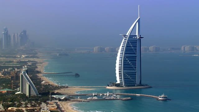 aerial over burj al arab, dubai, united arab emirates - golfstaaten stock-videos und b-roll-filmmaterial