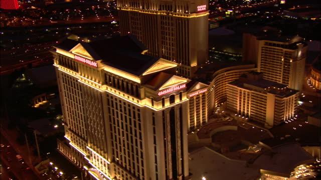 Aerial over Caesar's Palace on Las Vegas Strip at night / Las Vegas, Nevada