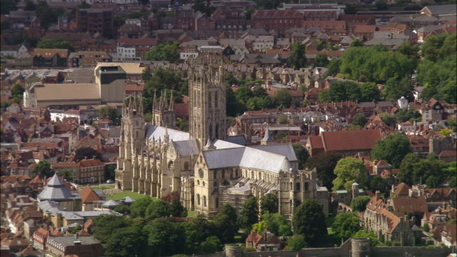 aerial over canterbury cathedral and the city of canterbury / kent, england - canterbury cathedral stock videos & royalty-free footage