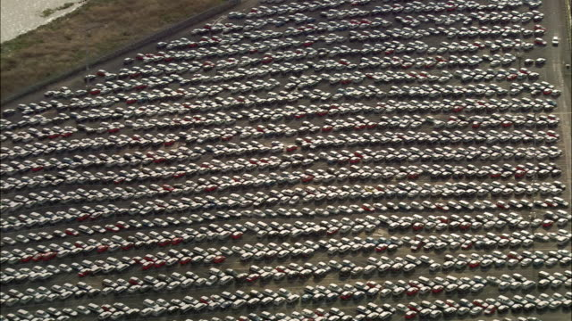 Aerial over cars parked in lot in Tilbury / Essex, England