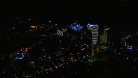 aerial over central berlin at night / over sony centre / berlin - night stock-videos und b-roll-filmmaterial
