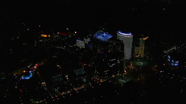 aerial over central berlin at night / over sony centre / berlin - berlin stock-videos und b-roll-filmmaterial