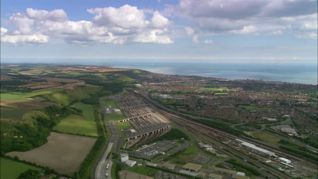 aerial over channel tunnel terminal / kent, england - english channel stock videos and b-roll footage