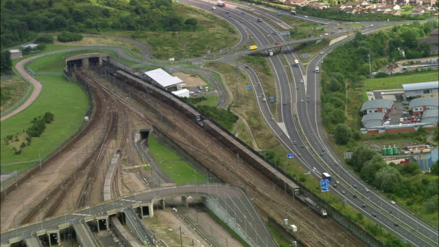 aerial over channel tunnel terminal / kent, england - eurotunnel folkestone stock-videos und b-roll-filmmaterial