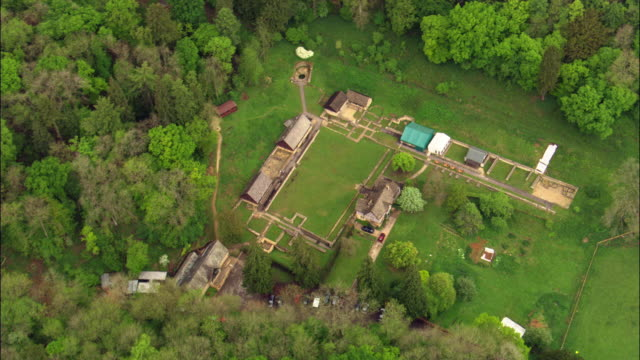 aerial over chedworth roman villa, cotswolds, uk - cotswolds stock videos & royalty-free footage