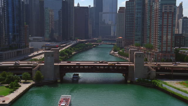 aerial over chicago skyline with chicago river in middle of frame - chicago river stock videos & royalty-free footage
