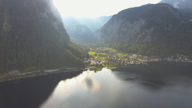 Aerial: over city and lake Hallstatt