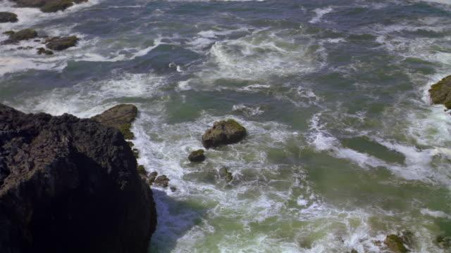aerial over cliffs along rocky coastline in canadian rockies / british columbia, canada - rocky coastline stock videos & royalty-free footage