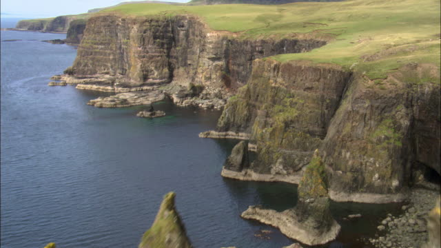 Aerial over cliffs and sea stacks, Isle of Skye, Scotland, UK