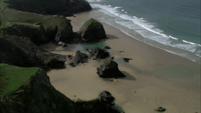 aerial over cliffs, beach and sea, cornwall, uk - coastal feature stock videos & royalty-free footage