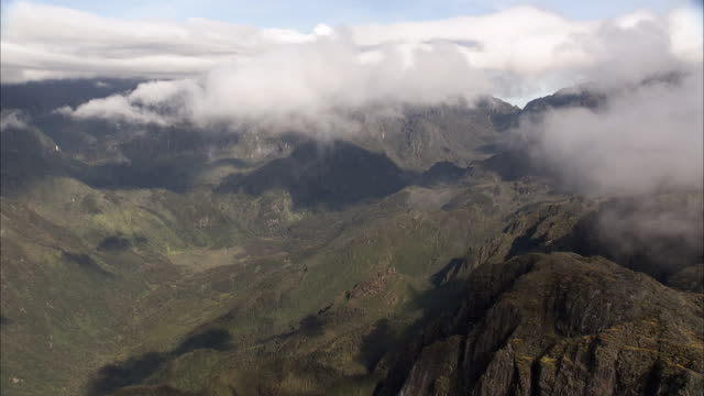 Aerial over cloud, mountains and valley, Rwenzori, Uganda