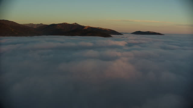 aerial over clouds - 30 seconds or greater stock videos & royalty-free footage