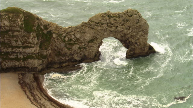 Aerial over coast and Durdle Door arch, Dorset, UK