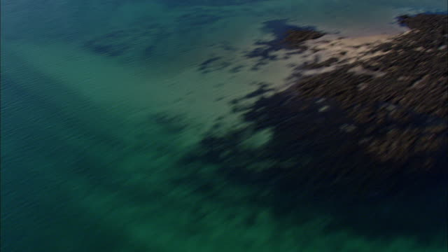 aerial over coast at low tide, jersey, uk - low tide stock videos & royalty-free footage