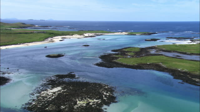 aerial over coast of outer hebrides, scotland, uk - hebrides stock videos & royalty-free footage