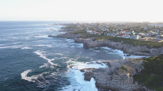 aerial over coastal landscape with rocky cliffs - hermanus stock videos & royalty-free footage