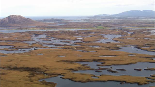 Aerial over coastal marshes on Isle of Skye, Scotland, UK