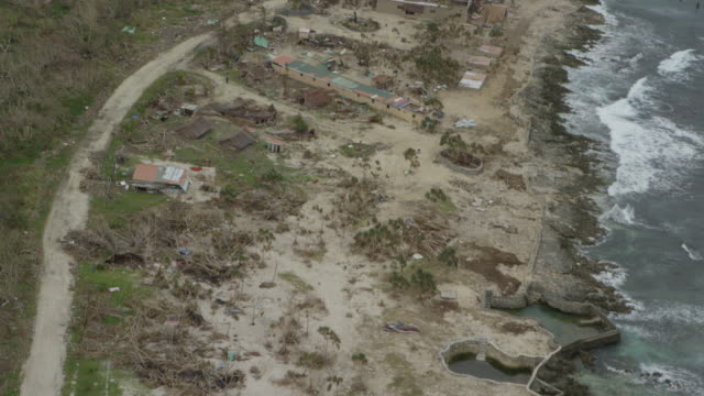 vanuatu - march 29, 2015: aerial over coastline, erosion, sand washed inland, buildings destroyed - pacific islands stock videos & royalty-free footage