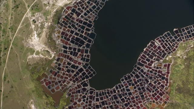 Aerial over colourful salt ponds on Lake Katwe, Uganda