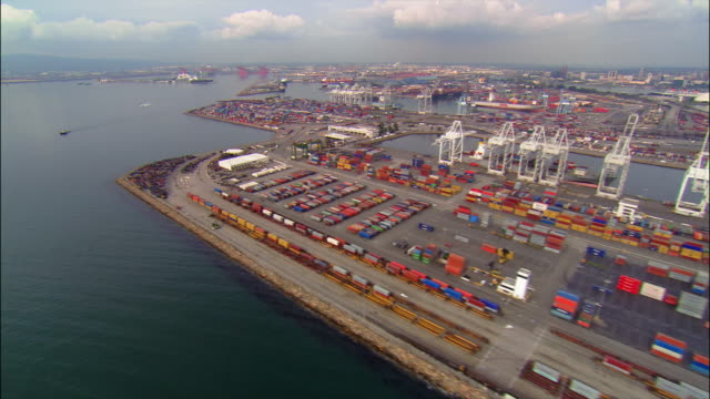 Aerial over container ship facilities at Long Beach Harbor / Long Beach, California