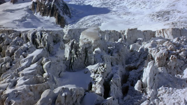 Aerial over crevasse of glacier in French Alps / France