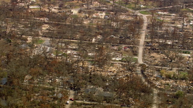 aerial over destroyed house plots in residential neighborhood / waveland, mississippi - 2005 stock videos & royalty-free footage