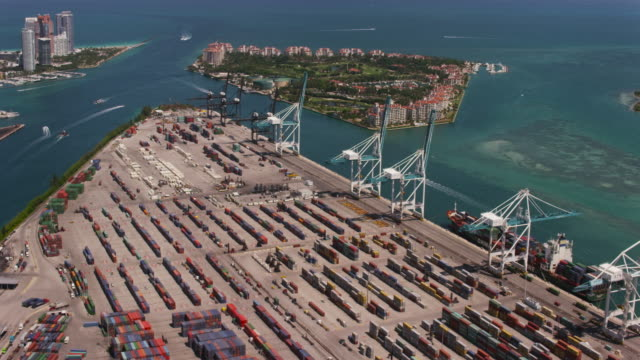 Aerial over Dodge Island with cranes and cargo ships in Miami FL