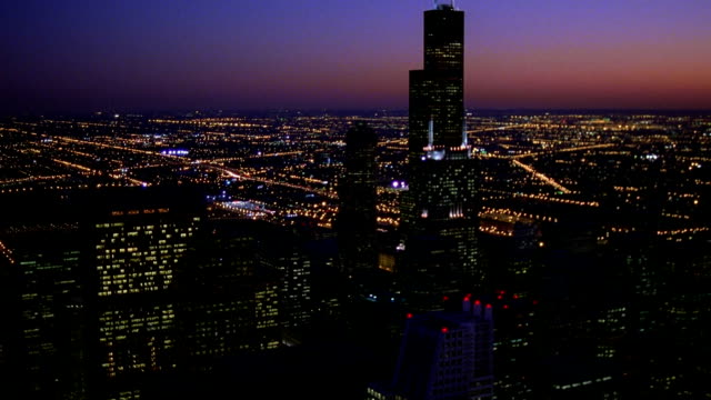 aerial over downtown chicago, towards and around sears tower at twilight / illinois - willis tower stock videos & royalty-free footage