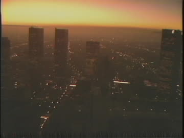 aerial over downtown los angeles at sunset in the 1980s - sunset boulevard los angeles stock videos & royalty-free footage
