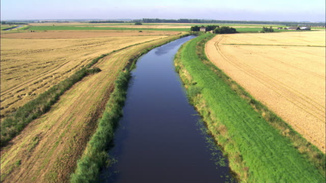 aerial over drainage channel in fenland, uk - fen stock videos and b-roll footage