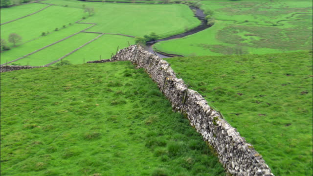 Aerial over dry stone wall and valley, Yorkshire, UK