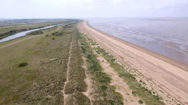aerial over dune grass along heacham beach - norfolk england stock videos and b-roll footage