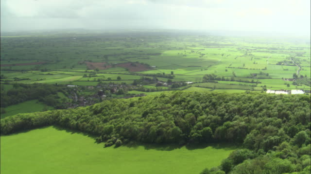 aerial over edge of mendip hills, somerset, uk - somerset england stock videos & royalty-free footage