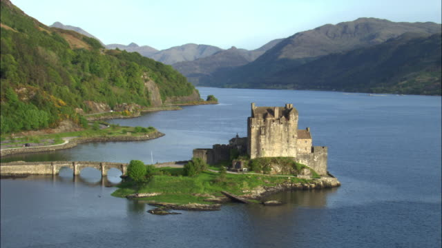 Aerial over Eilean Donan castle on loch, Scotland, UK