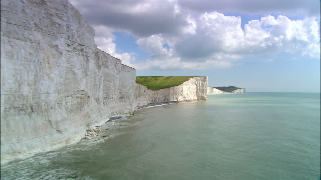 Aerial over English Channel and people walking on Seven Sisters chalk cliffs / East Sussex, England