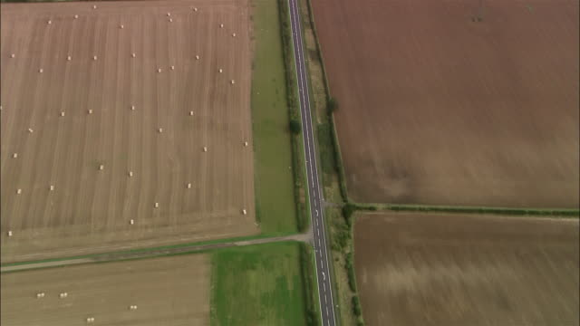 aerial over ermine street through cultivated fields north of london / lincolnshire, england - rural scene stock videos & royalty-free footage