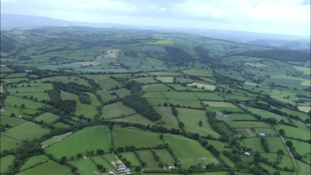 aerial over fields and farmland, yorkshire dales, uk - yorkshire england stock videos & royalty-free footage