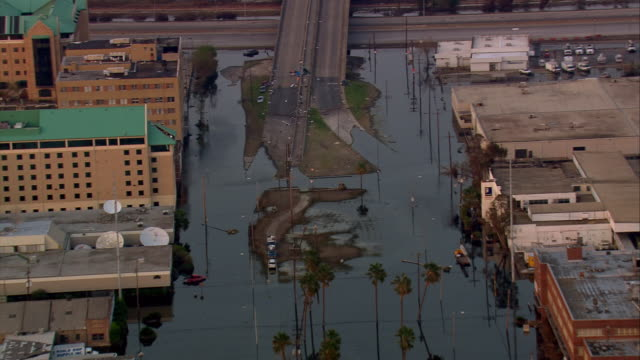 aerial over flooded street and elevated roadway in the gentilly neighborhood / new orleans louisiana - hurricane katrina stock videos and b-roll footage