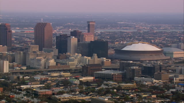 aerial over flooded streets and elevated highways downtown / past superdome / new orleans louisiana - hurricane katrina stock videos and b-roll footage