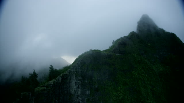 aerial over foggy mountain ridgetops, kauai, hawaii - kauai stock videos & royalty-free footage