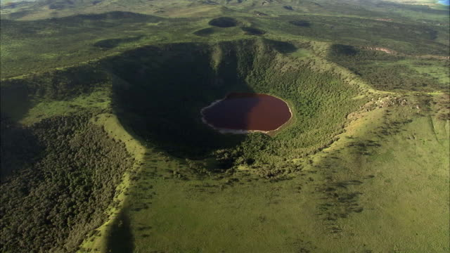 aerial over forest and extinct volcanic crater lake, uganda - extinct stock videos and b-roll footage