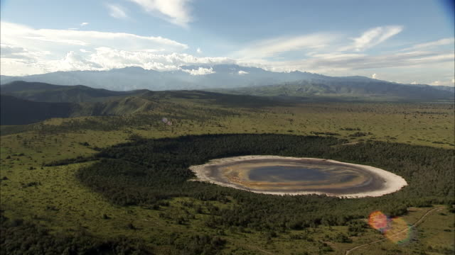 Aerial over forest and extinct volcanic crater lake, Uganda