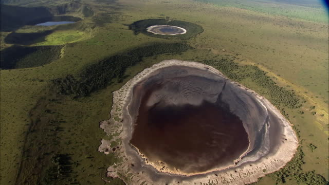 Aerial over forest and extinct volcanic crater lakes, Uganda