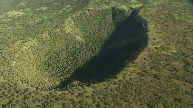aerial over forest in extinct volcanic crater, uganda - nationalpark stock-videos und b-roll-filmmaterial