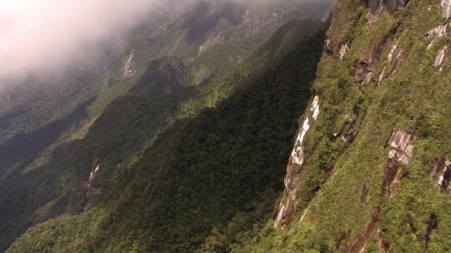 aerial over forested mountain peaks, madagascar - マダガスカル点の映像素材/bロール