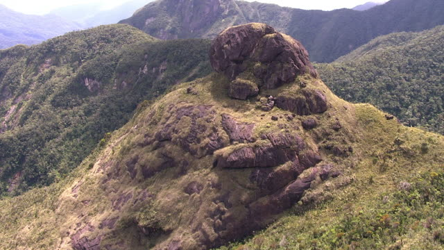 "stockvideo's en b-roll-footage met aerial over forested mountain peaks, madagascar - ""bbc natural history"""