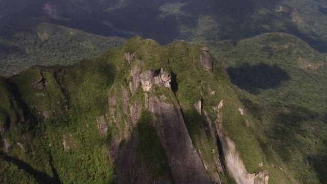 """aerial over forested mountain peaks, madagascar - """"bbc natural history"""" stock videos & royalty-free footage"""