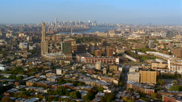aerial over fort greene, brooklyn with manhattan skyline and williamsburg bridge in background / nyc - williamsburg bridge stock videos & royalty-free footage