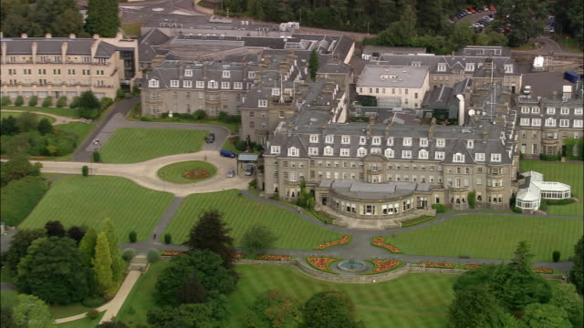 aerial over gleneagles hotel / zoom out over gleneagles golf course / perth and kinross, scotland - scottish culture stock videos & royalty-free footage